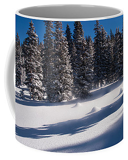 Coffee Mug featuring the photograph Blowing Snow On Top by Monte Stevens