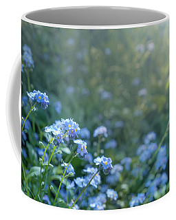 Coffee Mug featuring the photograph Blue Blooms by Gene Garnace