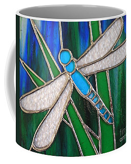 Blue Dragonfly On Reeds With Bluey Green Background Coffee Mug
