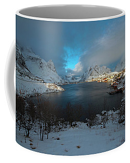 Coffee Mug featuring the photograph Blue Hour Over Reine by Dubi Roman