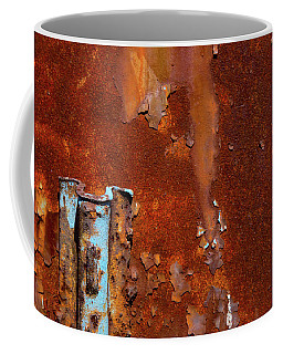 Coffee Mug featuring the photograph Blue On Rust by Karol Livote