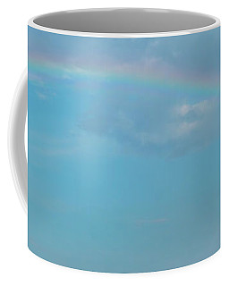 Coffee Mug featuring the photograph Blue Skies With Storm Clouds And Rainbow by PorqueNo Studios