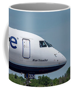 Coffee Mug featuring the photograph Blue Traveller by Guy Whiteley