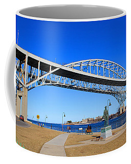 Coffee Mug featuring the photograph Blue Water Bridge by Michael Rucker