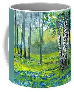 Coffee Mug featuring the painting Bluebells And Birches by Val Stokes