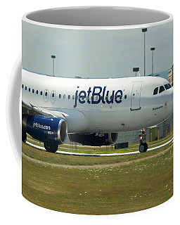 Coffee Mug featuring the photograph Blumanity by Guy Whiteley