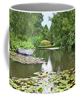Coffee Mug featuring the photograph Boat On The Lake by Gill Billington