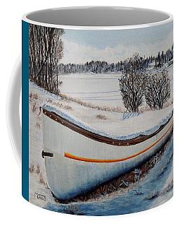 Boat Under Snow Coffee Mug