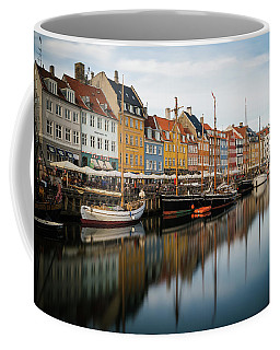 Coffee Mug featuring the photograph Boats At Nyhavn In Copenhagen by James Udall