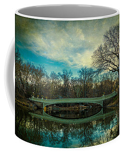 Coffee Mug featuring the photograph Bow Bridge Reflection by Chris Lord
