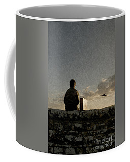 Boy On Wall Coffee Mug