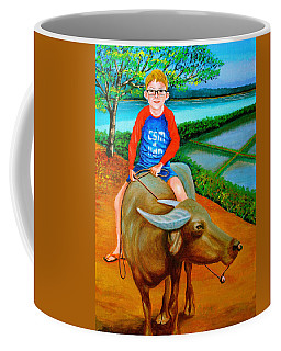 Boy Riding A Carabao Coffee Mug by Cyril Maza