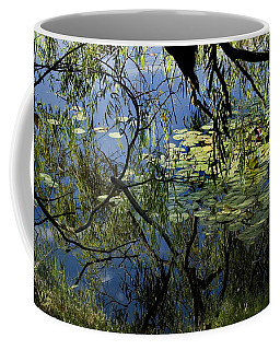 Branches Of Trees Reflected In A Lily Coffee Mug