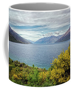 Coffee Mug featuring the photograph Broom Bushes On Lake Wakatipu New Zealand by Joan Carroll