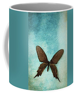 Brown Butterfly Over Blue Textured Background Coffee Mug