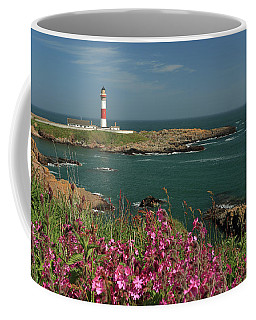 Coffee Mug featuring the photograph Buchan Ness Lighthouse And Spring Flowers by Maria Gaellman