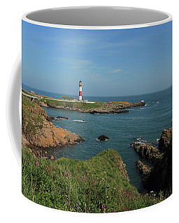 Coffee Mug featuring the photograph Buchan Ness Lighthouse And The North Sea by Maria Gaellman