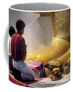 Coffee Mug featuring the photograph Buddhist Thai People Praying by Heiko Koehrer-Wagner