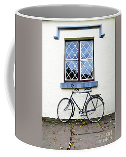 Coffee Mug featuring the photograph Bunratty Bike by Rick Locke
