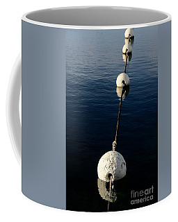 Coffee Mug featuring the photograph Buoy Descending by Stephen Mitchell