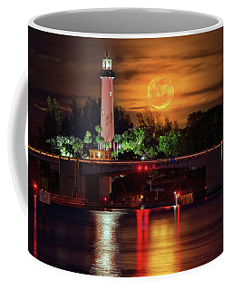 Coffee Mug featuring the photograph Burning Moon Rising Over Jupiter Lighthouse by Justin Kelefas
