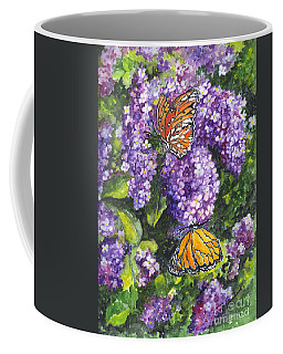 Coffee Mug featuring the painting Butterflies And Lilacs by Carol Wisniewski