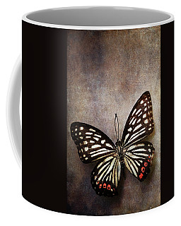 Butterfly Over Textured Background Coffee Mug