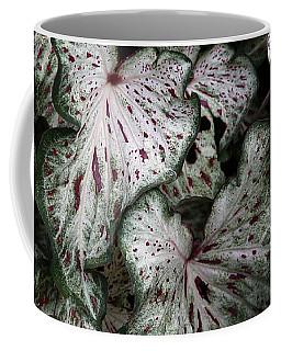 Coffee Mug featuring the photograph Caladium Leaves by Debi Dalio