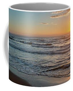 Calm Water Over Wet Sand During Sunrise Coffee Mug