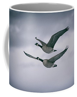 Coffee Mug featuring the photograph Canadian Geese In Flight by Jason Coward