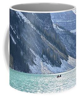 Canoeing On Lake Louise Coffee Mug by Keith Boone