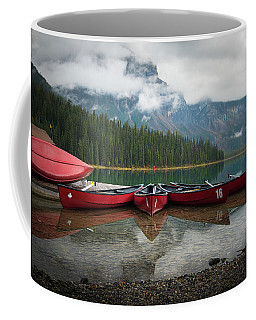 Coffee Mug featuring the photograph Canoes At Emerald Lake by James Udall