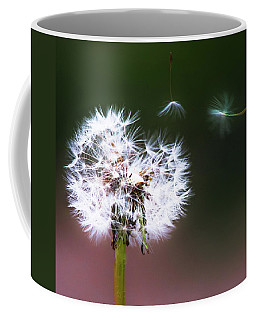 Coffee Mug featuring the photograph Carried By The Wind by Parker Cunningham