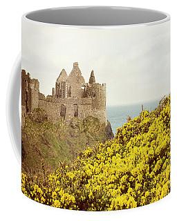 Coffee Mug featuring the photograph Castle Ruins And Yellow Wildflowers Along The Irish Coast by Juli Scalzi