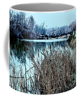Coffee Mug featuring the photograph Cattails On The Water by Sandy Moulder
