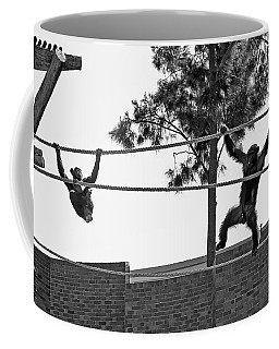 Coffee Mug featuring the photograph Chimps In Black And White by Miroslava Jurcik