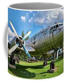 Coffee Mug featuring the photograph Chrome Bird by Tgchan