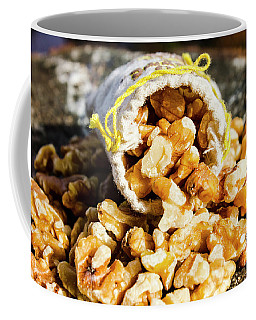Closeup Of Walnuts Spilling From Small Bag Coffee Mug
