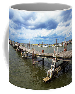 Coffee Mug featuring the photograph Clouds Over The Dock by John Rizzuto
