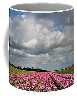 Clouds Over The Purple Tulip Field Coffee Mug by Mihaela Pater