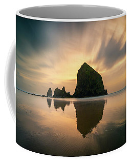 Coffee Mug featuring the photograph Cloudy Sunset At Cannon Beach by James Udall