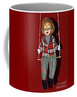 Coffee Mug featuring the photograph Clown On Swing By Kaye Menner by Kaye Menner