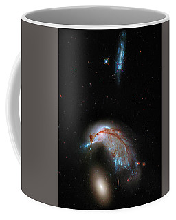 Coffee Mug featuring the photograph Colliding Galaxy by Marco Oliveira