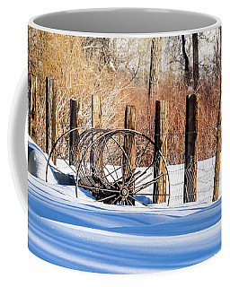 Coffee Mug featuring the photograph Colorado Winter Snow Scene With Old Farming Rake And Rustic Fence by Nadja Rider