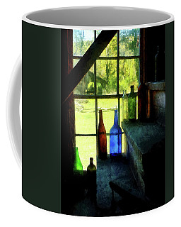 Coffee Mug featuring the photograph Colored Bottles On Steps by Susan Savad
