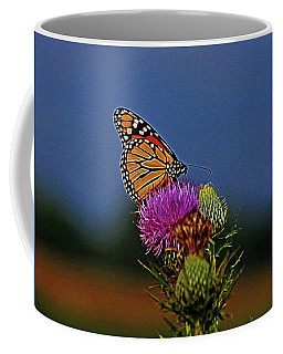 Coffee Mug featuring the photograph Colorful Monarch by Sandy Keeton