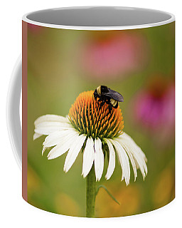 Coffee Mug featuring the photograph Coneflower And Bee by Phyllis Peterson