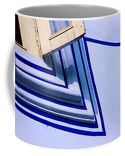 Coffee Mug featuring the photograph Cornering The Blues by Prakash Ghai
