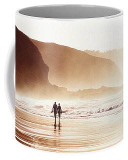 Couple Walking On Beach With Fog Coffee Mug