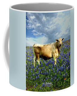 Coffee Mug featuring the photograph Cow And Bluebonnets by Barbara Tristan
